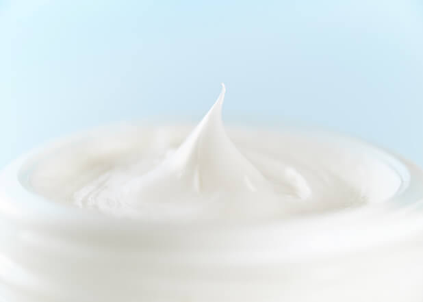 Close-up of cream blue background
